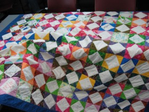Quilt laying on the table with signatures